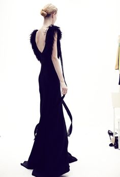 I hate feathers- but with this dress- I'll give them a chance !