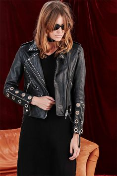 The eye is in the detail of this leather jacket which takes on a new dimension to the classic piece. Studs are thoughtfully placed in line with the oversized collar, pockets and zips. Eight large eyelets create a bold statement on each sleeve while buttons and zips give purpose in the form of looks and functionality. Winter 2017 Size & Fit: Model is 177cm tall Model wears a NZ 8/ NZ S/ EU 36/ US 4 Wash Guide: Dryclean only. Select a high quality leather drycleaner.Gentle short cycle. Low moi