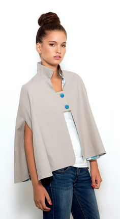 This chic gray cape has a peekaboo printed lining. #etsyfinds