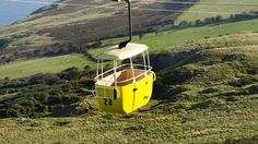 Check out Great Orme Aerial Cable Cars in Llandudno. Enjoy spectacular views of Puffin Island, Anglesey and the mountains of Snowdonia! Car Station, Snowdonia, Days Out, Car Ins, Wind Turbine, Places To Go, Cable, Kids, Cabo