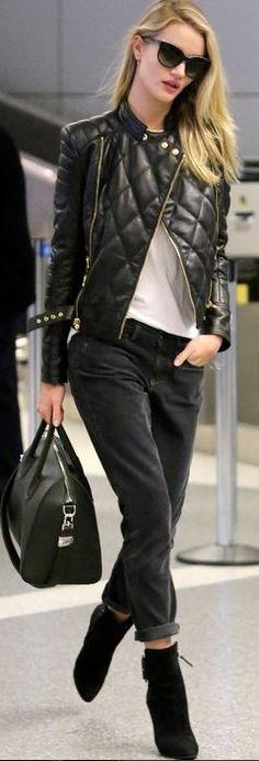 Who made  Rosie Huntington-Whiteley's gray pants, green handbag, sunglasses, and black leather jacket?