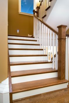 Distinctive Interiors - Custom matched Oak Stair materials with white Risers and Spindles