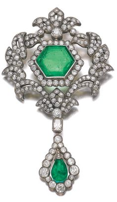 EMERALD AND DIAMOND PENDENT BROOCH, 19TH CENTURY  Set at the centre with a hexagonal step-cut emerald, within an open work of foliate design decorated with circular- and single-cut diamonds, suspending a detachable swing-set emerald drop framed with circular- and a mixed-cut diamond, fitted case.
