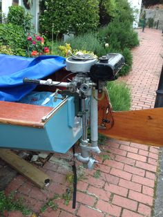 Vintage British seagull outboard motor for use with the boat when not sailing .
