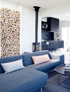 Modern contemporary kitchen, living room with a functional yet decorative way to store wood as a wall-feature, as art. LOVE it. I don't have a fireplace, but still want to do this!