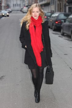 black coat with a red scarf