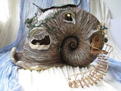 For centuries shells and horns were made into, well, horns, but how many have been made into a fairy house? This slightly creepy fantasy creation is still amazing.