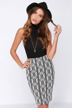 Rewrite last season's look with a new love: the Monochromeo and Juliet Black and Ivory Print Midi Skirt! A bold ivory print cascades in mesmerizing fashion down a bodycon, stretch knit skirt, with an elasticized waist that offers a perfect high-waisted fit. Pair with a sassy crop top for a night out, or a button-up blouse for an office chic look! Unlined. 58% Cotton, 40% Polyester, 2% Spandex. Hand Wash Cold or Dry Clean. Made with Love in the U.S.A.