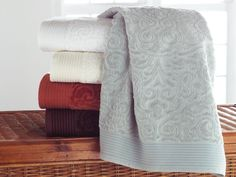 """Park Avenue  Designer: Peacock Alley    If you think they look plush wait until you feel the Park Avenue towel by Peacock Alley. This gorgeous modern velour jacquard reverses to terry to create an extraordinary hand and maximum absorption.    Wash / 13"""" x 13"""" $8  Hand / 19"""" x 31"""" $18  Guest / 12"""" x 19"""" $19  Bath / 27"""" x 54"""" $28    100% Long Staple Cotton  600 Gram Weight  Imported  Available colors- Chocolate, Glacier, Ivory, Terra Cotta and White  (White... of course!!)"""