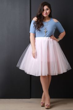 This plus size semi-sheer knee length skirt features layers of tulle and a wide elasticized waist. Mini skirt semi-lining. Accessories sold separately. Made in U.S.A. 100% Polyester. Measurement Size