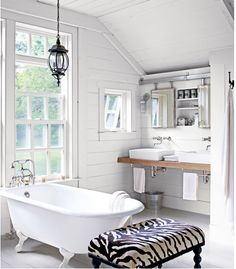 I like how everything is exposed,  the pipes under the sink, etc. Really rustic & clean look.
