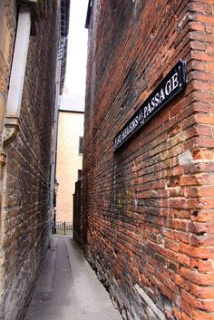 St Helens Passage which leads to the famous Turf Tavern in Oxford, England.  The Turf Tavern is a 13th century ale house and a popular traditional english pub. Legend states The Turf is allegedly haunted by a 'lady in grey' who wanders around the back garden.  Photo: found on geograph.org.uk