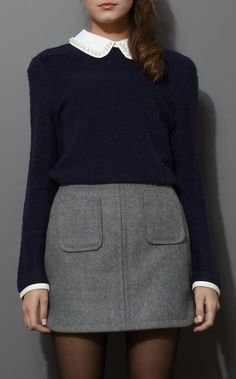 I love the peter pan collar with pearl beading detail and navy sweater over gray wool skirt.  classic