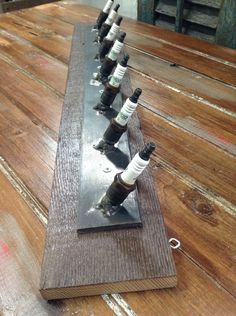 A personal favorite from my Etsy shop https://www.etsy.com/listing/288421731/spark-plug-coat-rack-belt-or-tie-hooks