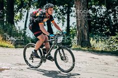 Miass, Russia - July 19, 2015: mountainbiker rides along the lake during race 'Clean water-2015', Miass, Russia - July 19, 2015