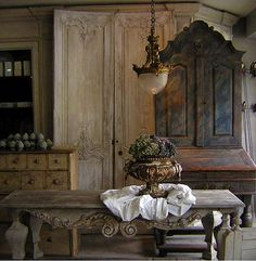 French antiques...the light is stunning and I love all the detail in the wood furniture.  It's just not made like that anymore.  So much character!