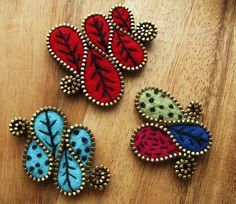 felt and zipper brooches...by woolly fabulous