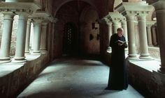 Benedictine Monks | benedictine monk reads in the cloister of a monastery photograph ...