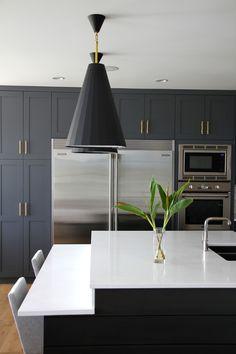 Kitchen Reveal. Blue grey cabinets, quartz countertops, a dash of open shelving, subway tiles and a pair of Jonathan Adler Antwerp pendants.