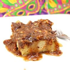 New Orleans Style Bread Pudding drizzled with a delicious Coconut Praline Sauce. This dessert combines two of New Orleans most beloved desserts-bread pudding and pralines. Bread pudding was traditi...