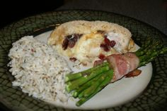 Brie, cranberry and apple stuffed chicken served with bacon wrapped asparagus and long grain rice.