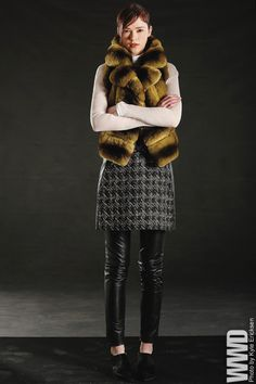 J. Mendel's chinchilla vest, metallic wool sheath, silk blouse and leather pants. Sigerson Morrison booties