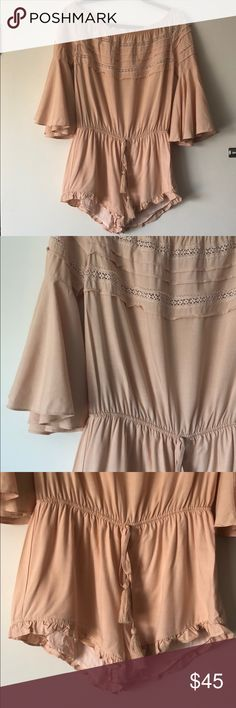 NASTY GAL // off the shoulder ruffled romper brand new, never worn, off the shoulder romper, with lace detail and ruffled sleeves. it's a peachy color, third photo is most accurate in that lighting. would look great dressed up with your favorite wedges or worn casually with a pair of white sneakers! Nasty Gal Other