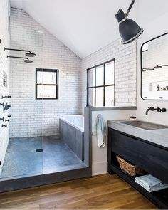 Gorgeous modern bathroom space - large walk in shower with granite floors and vanity.