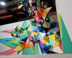 Created for the ARCO International Contemporary Art Fair by Spanish street artist Nuria Mora, this incredible installation includes loads of geometric  paper shapes