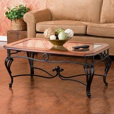 Enhance your living room decor with this elegant glass top cocktail table. The handcrafted iron scroll legs and beveled glass top give this traditionally-styled table a high-class appearance, and the dark cherry trim adds a touch of style. Glass Top Coffee Table, Coffee Table With Storage, Glass Table, Iron Furniture, Furniture Deals, Table Furniture, Furniture Outlet, House Furniture, Online Furniture