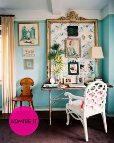 This office is a chic, eclectic mix of feminine glamor. A bright turquoise paint color serves as the backdrop for randomly hung vintage art and family photographs. There's no doubt that hers is a mix of high-end antiques she has collected over time.