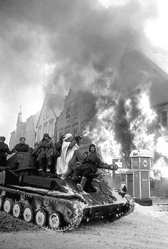 Red Army troops pass a burning gas station in Berlin, 1945. Pin by Paolo Marzioli