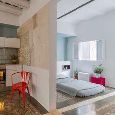 Nook's Barcelona apartment refurb removes walls but leaves original tiled floors intact