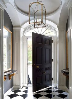 Black walls and doors, extensive white molding. Beacon Hill residence, Boston. Siemasko + Verbridge.