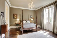 Traditional Master Bedroom with American drew grove pediment four poster bed, Hardwood floors, Carpet, Crown molding