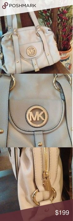 Michael Kors Shoulder Bag This Michael Kors cream leather shoulder bag is the perfect accessory to pair with any outfit this season. The white/cream leather is accented by stylish gold Michael Kors emblems to give you a sharp and stylish high end look. Michael Kors Bags Shoulder Bags