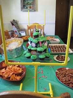 Football party! These PVC goal posts are pretty much brilliant! Fun football shaped foods, and team color cupcakes!
