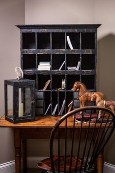 ANTIQUE DESK with MAIL CUBBY, ANTIQUE LANTERN, FOLK ART HORSES, and AN ANTIQUE WINDSOR.
