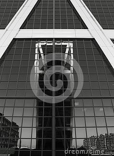 Shot in black and white, a view on the reflection of the facade of the Kio Towers building,  set in Madrid, Castilla, Spain, España, Europa, Europe