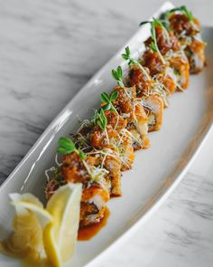 """The """"Loco Maguro"""" roll stars fresh Aburi salmon with spicy tuna (both inside and on top.) Drizzled with a sweet ponzu sauce."""