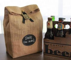 Personalized gift-wrapping for 6-packs of craft brews custom picked for the beer lover in your life. Tie on a bottle opener and they're set. Bonus: wipe the label clean, roll down the top and use as a potted flower sack or centerpiece.