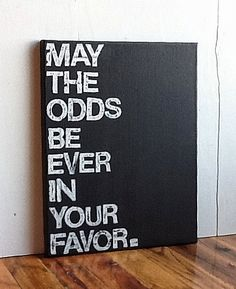 11X14 Canvas Sign - May The Odds Be Ever In Your Favor, The Hunger Games Quote, Typography Word Art, Gift, Decoration, Black and White. $25.00, via Etsy. Great for Christmas!