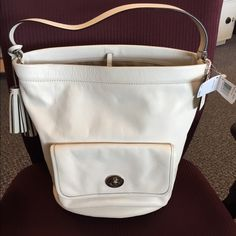 """Coach Legacy Archival Bucket Bag-Parchment Authentic.  100% genuine leather in a gorgeous off white... Exterior features a large pocket w/ clasp closure, hanging tassel, & hook closure... Interior features a light cotton fabric, 2 multi function pockets, & back wall zip pocket... Measures 14""""W x 12""""H x 8""""D w/ about a 6 1/2"""" strap drop (will Lower as items fill inside bag)...perfect off white for all year round, but especially gorgeous in spring/summer... Great everyday size... Minimal use…"""