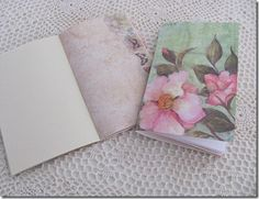 handmade journals using scrapbook papers, machine stitched