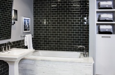 Luxury glass Subway tile mixed with a Carrara Marble Mosaic tub surround.