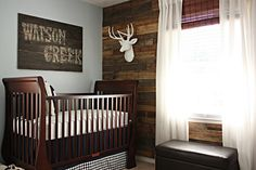 cabin themed nursery - love the wood wall and wood sign