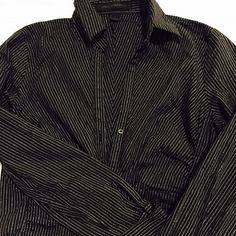 Express black and silver button down top Professional and sexy black and silver top. It fits fitted. Stretchy material. Express Tops Button Down Shirts