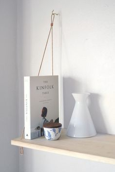 Yield's Pantry Shelf is a modern suspension shelf made in San Francisco from natural pine and heavy-duty bronze cable. The shelf was ins… Plant Shelves, Hanging Shelves, Library Furniture, Home Furniture, Swedish Design, Scandinavian Design, Spare Room Office, The Kinfolk Table, Ladder Shelf Diy