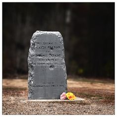 Stone at the site where Clyde Barrow and Bonnie Parker died, riddled by gunshots just as she and Clyde were on May 23, 1934.
