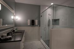 Transitional 3/4 Bathroom with Wainscoting, Raised panel, frameless showerdoor, complex marble tile floors, High ceiling